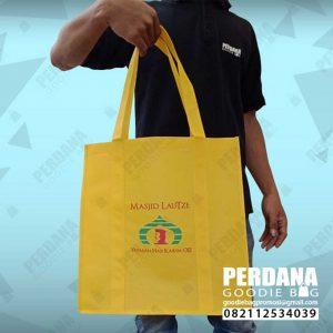 souvenir tas untuk yayasan bahan spunbond kuning lautze by Perdana id3481