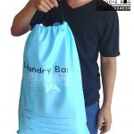 tas laundry spunbond biru model serut di Perdana Goodie Bag