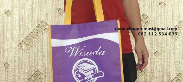souvenir unik bahan spunbond ungu dan kuning di Manado by Perdana id4470